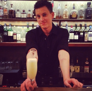 My friend, whipping up delicious drinks, as I write this post at his restaurant bar